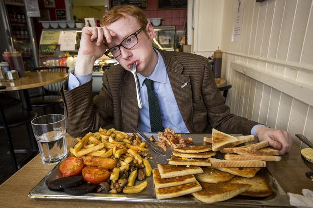 Wood V Food. Sunday Life reporter Chris Woodhouse takes on his latest eating challenge as he attempts to eat a 34-piece fry at the Newton cafe on the Newtownards Road in Belfast. Picture: Mark McCormick