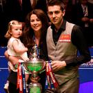 Top of the world: Mark Selby with wife Nikki and daughter Sophia