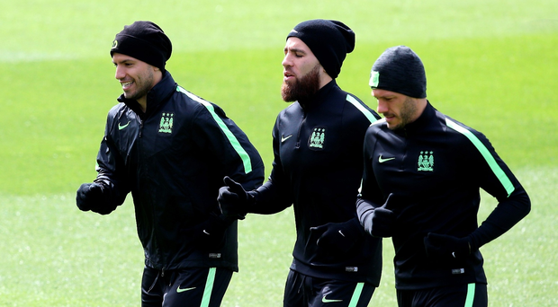 On a mission: Sergio Aguero, Nicolas Otamendi and Martin Demichelis train in Madrid ahead of Manchester City's bid to reach the Champions League final for the first time