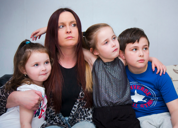 Joanne McGibbon, widow of murdered taxi driver Michael, in her home with children Corey-Leigh (white top), Michaela and Shea