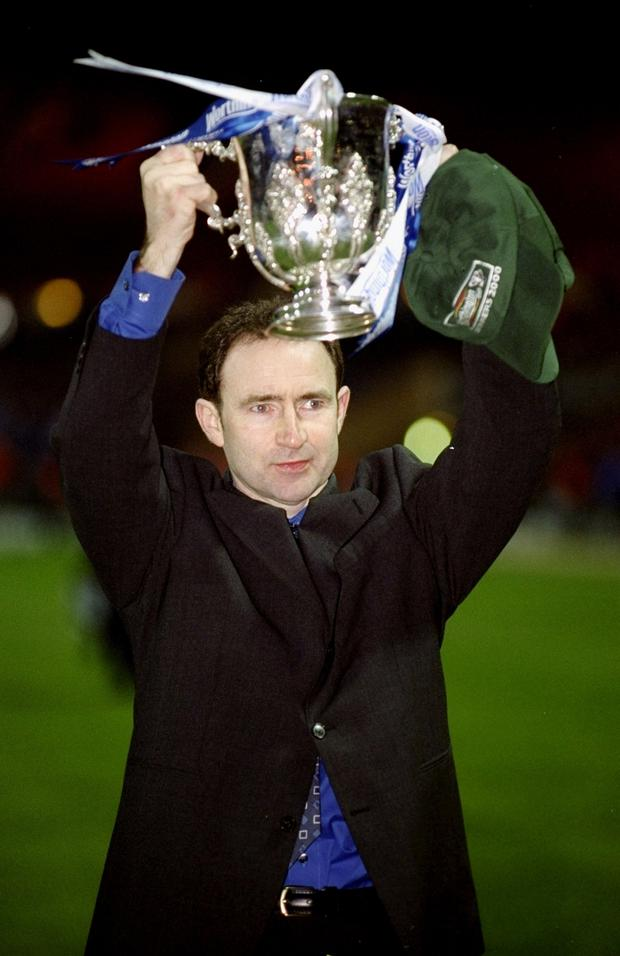 Memories: Martin O'Neill lifts one of two League Cups won with Leicester