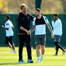 Liverpool manager Jurgen Klopp (left) with Danny Ings during a training session at Melwood Training Ground, Liverpool. PA