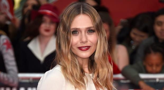 Red carpet treatment: Elizabeth Olsen arrives for UK film premiere