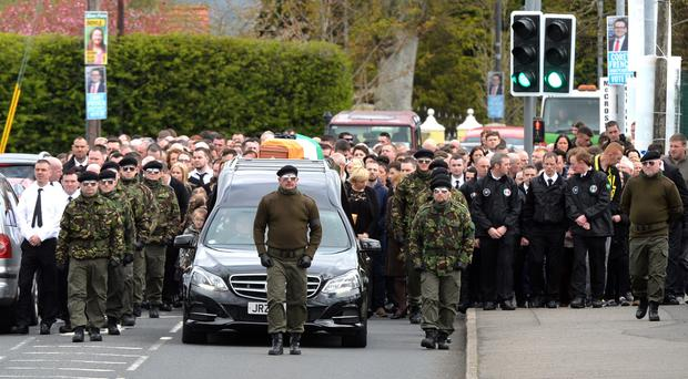 A guard of honour flanks the coffin of Michael Barr at his funeral in Strabane Co Tyrone this morning. Barr was shot dead at the end of April in a pub in Dublin. It is thought his murder is part of a bitter feud between rival gangs in the city. PACEMAKER BELFAST 05/05/2016