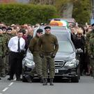 A guard of honour flanks the coffin of Michael Barr at his funeral in Strabane Co Tyrone this morning. Barr was shot dead at the end of April in a pub in Dublin. PACEMAKER BELFAST 05/05/2016