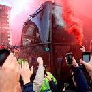 Liverpool fans light flares and surround the Villarreal team bus prior to the UEFA Europa League, Semi Final, Second Leg at Anfield, Liverpool. PRESS ASSOCIATION Photo. Picture date: Thursday May 5, 2016. PA