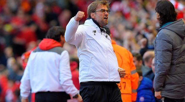 Liverpool's German manager Jurgen Klopp celebrates his team's first goal during the UEFA Europa League semi-final second leg football match between Liverpool and Villarreal CF at Anfield in Liverpool, northwest England on May 5, 2016. / AFP PHOTO / LLUIS GENELLUIS GENE/AFP/Getty Images