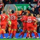 Liverpool players celebrate their first goal during the UEFA Europa League semi-final second leg football match between Liverpool and Villarreal CF at Anfield in Liverpool, northwest England on May 5, 2016. AFP/Getty Images