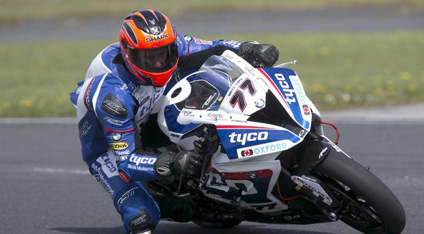 Powering ahead: Ryan Farquhar tries out the Tyco BMW Superbike at Kirkistown ahead of the North West 200