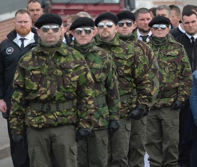 Controversial: A guard of honour flanks the coffin of Michael Barr at his funeral in Strabane Co Tyrone this morning