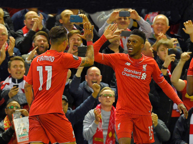On our way: Daniel Sturridge celebrates with Roberto Firmino after scoring Liverpool's second goal