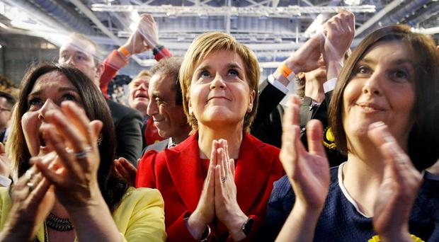 SNP leader Nicola Sturgeon reacts as results come in at a Scottish Parliament election count at the Emirates Arena in Glasgow, Scotland. Photo credit: Danny Lawson/PA Wire