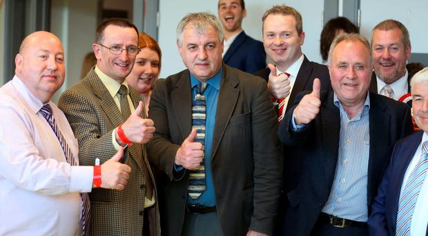 Maurice Bradley of the DUP (centre) celebrates his election as an MLA for East Londonderry, as the counting of votes continues at the Foyle Arena in Londonderry in the Foyle and East Londonderry constituencies in the Northern Ireland Assembly Elections. PRESS ASSOCIATION Photo. Picture date: Friday May 6, 2016. See PA story ULSTER Election. Photo credit should read: Niall Carson/PA Wire