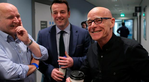 (left to right) Pundit Paul McFadden, SDLP Leader Colum Eastwood and People Before Profits Eamonn McCann share a joke at the Foyle Arena in Londonderry, as counting of votes continues in the the Foyle and East Londonderry constituencies in the Northern Ireland Assembly Elections. PRESS ASSOCIATION Photo. Picture date: Friday May 6, 2016. See PA story ULSTER Election. Photo credit should read: Niall Carson/PA Wire