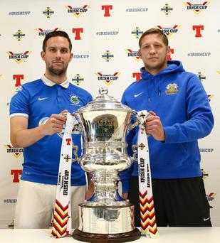 Up for the Cup: Linfield captain Andy Waterworth and Glenavon skipper Kris Lindsay will be aiming to get their hands on the Irish Cup after the final at a sold-out Windsor Park