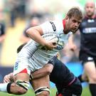 Chris Henry of Ulster is tackled by Sam Davies of Ospreys.