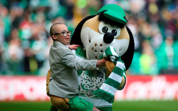 Celtic ambassador Jay Beatty and Hoopy the Huddle hound during the Ladbroke Scottish Premiership match between Celtic and Aberdeen at Celtic Park on May 8, 2016 in Glasgow. Photo by Ian MacNicol/Getty Images
