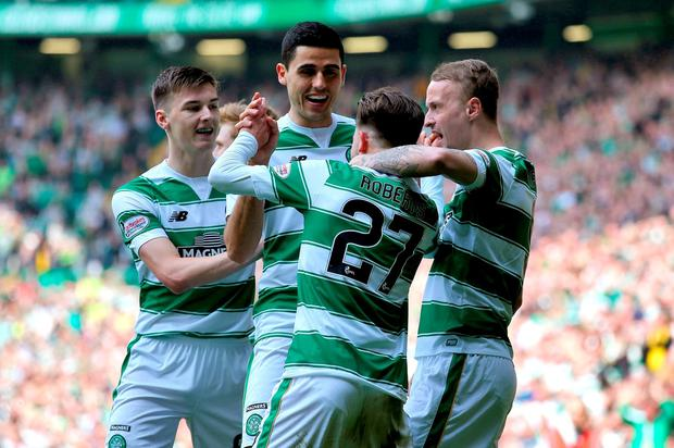 Celtic's Patrick Roberts (27) celebrates scoring his side's first goal during the Ladbrokes Scottish Premiership match at Celtic Park, Glasgow. Andrew Milligan/PA Wire.