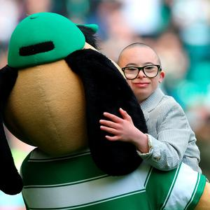 GLASGOW, SCOTLAND - MAY 08: Celtic Club ambasadorJay Beatty and Hoopy the Huddle hound during the Ladbroke Scottish Premiership match between Celtic and Aberdeen at Celtic Park on May 8, 2016 in Glasgow, Scotland. (Photo by Ian MacNicol/Getty Images)