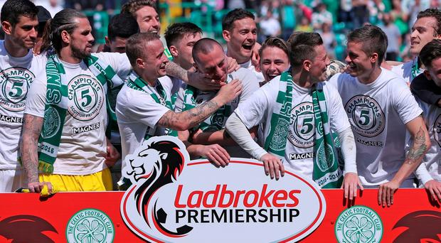 Celtic players celebrate after winning the Ladbrokes Scottish Premier League match following their clash Aberdeen at Celtic Park on May 8, 2016 in Glasgow, Scotland. Photo by Ian MacNicol/Getty images