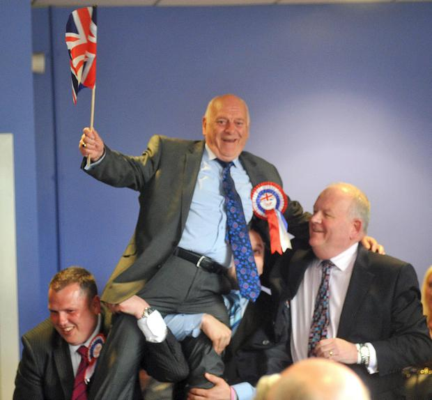Councillor Tommy Jeffers (DUP) celebrates his election.
