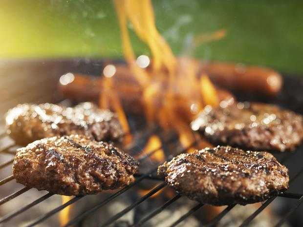Hot stuff: but don't squash those burgers, as it will cause flare-ups