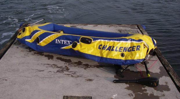 The inflatable dinghy used by the rescued men had an outboard engine and showed signs of patching