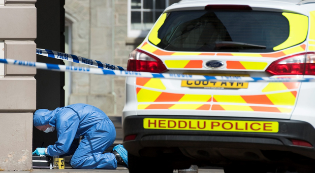 The police forensic team investigate the scene after a soldier died on his way to hospital having been found found injured and unconscious in the town centre on May 08, 2016 in Brecon, United Kingdom. (Photo by Matthew Horwood/Getty Images)