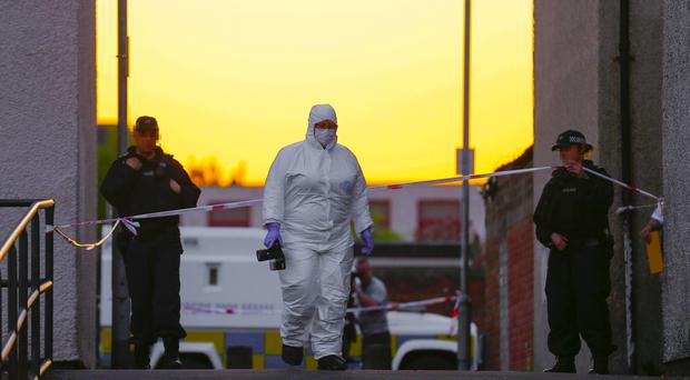 Police and forensics at the scene where a teenager has been shot several times in the leg in the Carlisle Square area of north Belfast ( Photo by Kevin Scott / Presseye )