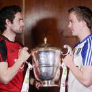 Up for the Cup: Down's Kevin McKernan and Monaghan's Jack McCarron get their hands on the silverware during the launch of the 2016 Ulster Senior Football Championship