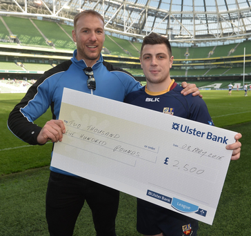 Boost: Ulster Bank Rugby Ambassador Stephen Ferris presents Banbridge's Adam Doherty with a £2,500 cheque after the 'Drop Kick for Your Club' event