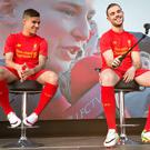 Looking the part: Liverpool's Philippe Coutinho and Jordan Henderson share a joke as the team's 2016-17 home kit is revealed yesterday