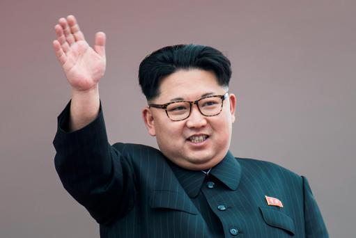 North Korean leader Kim Jong-Un waves from a balcony of the Grand People's Study House following a mass parade marking the end of the 7th Workers Party Congress in Kim Il-Sung Square in Pyongyang on May 10, 2016. North Korea kicked off a massive parade in the centre of Pyongyang on May 10 to celebrate a just-concluded ruling party congress that was seen as a formal coronation for supreme leader Kim Jong-Un. / AFP PHOTO / Ed JonesED JONES/AFP/Getty Images