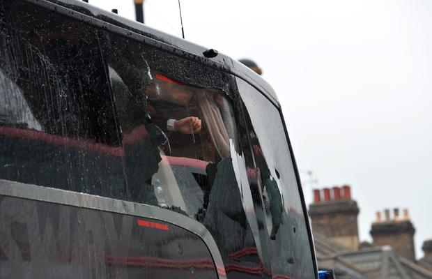 Manchester United team coach has a window smashed on its way to West Ham's Boleyn. AFP/Getty Images