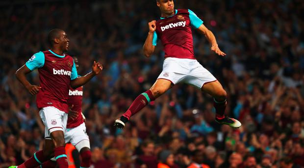 Winston Reid of West Ham United celebrates as he scores their third goal during the Barclays Premier League match between West Ham United and Manchester United at the Boleyn Ground on May 10, 2016 in London, England. (Photo by Julian Finney/Getty Images)
