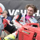 Star of the future: Glenn Irwin can see big things ahead for rising ace Malachi Mitchell-Thomas, pictured taking a break from the action on the north coast
