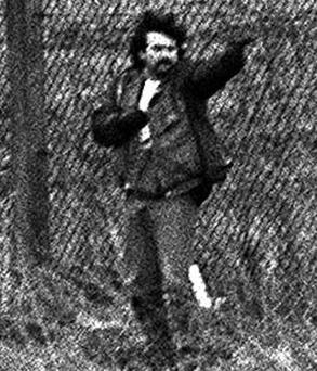 Loyalist gunman Michael Stone attacks mourners at an IRA funeral in Milltown cemetry in March 1988