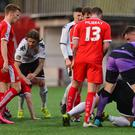 Cliftonville and Glentoran players involved in a mass brawl at the half time whistle during the game at Solitude in Belfast. Picture By: Arthur Allison/Pacemaker Press