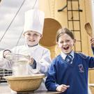 Jake Brooks and Ally Millar from Macosquin Primary School launch SS Nomadics search for a Petit Pâtisserie Chef! If your child is the Icing on the Cake or the Crème de la Crème when it comes to baking, visit www.titanicbelfast.com for a chance to win a school trip to SS Nomadic. Picture by Brian Morrison.