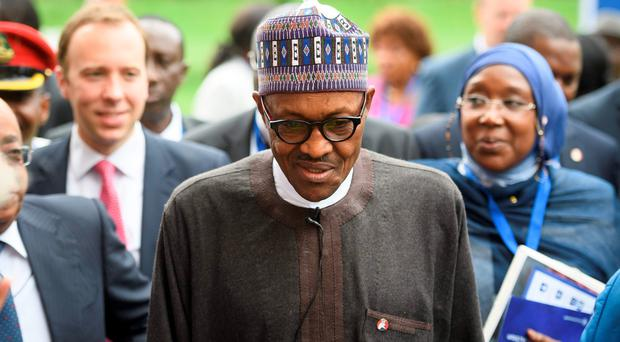 Nigerian President Muhammadu Buhari leaves after addressing delegates at the start of a conference to tackle corruption at the Commonwealth Secretariat in London on May 11, 2016. AFP/Getty Images