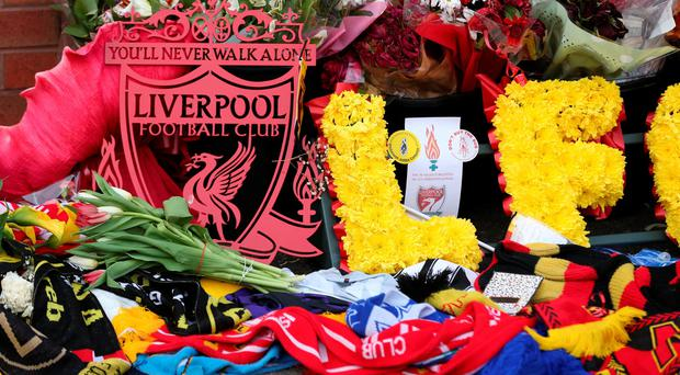 Flowers and scarves are left outside the ground to remember those people who lost their lives in the Hillsborough disaster prior to the Barclays Premier League match between Liverpool and Chelsea at Anfield on May 11, 2016 in Liverpool, England. (Photo by Chris Brunskill/Getty Images)