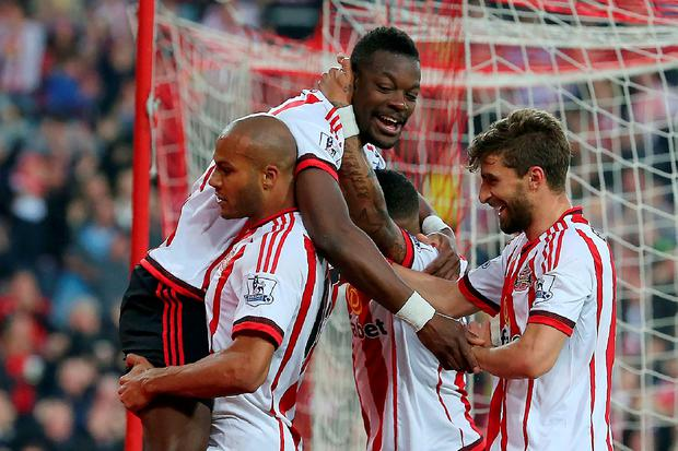 Sunderland's French-born Ivorian defender Lamine Kone (Top) celebrates after scoring his team's third goal during the English Premier League football match between Sunderland and Everton at the Stadium of Light in Sunderland, north east England on May 11, 2016. AFP/Getty Images