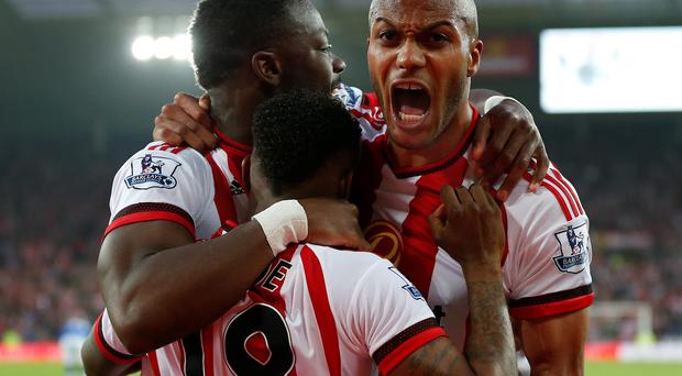 Sunderland's Lamine Kone (left) celebrates scoring his side's third goal of the game with teammates Younes Kaboul and Jermain Defoe during the Barclays Premier League match at the Stadium of Light, Sunderland. PA