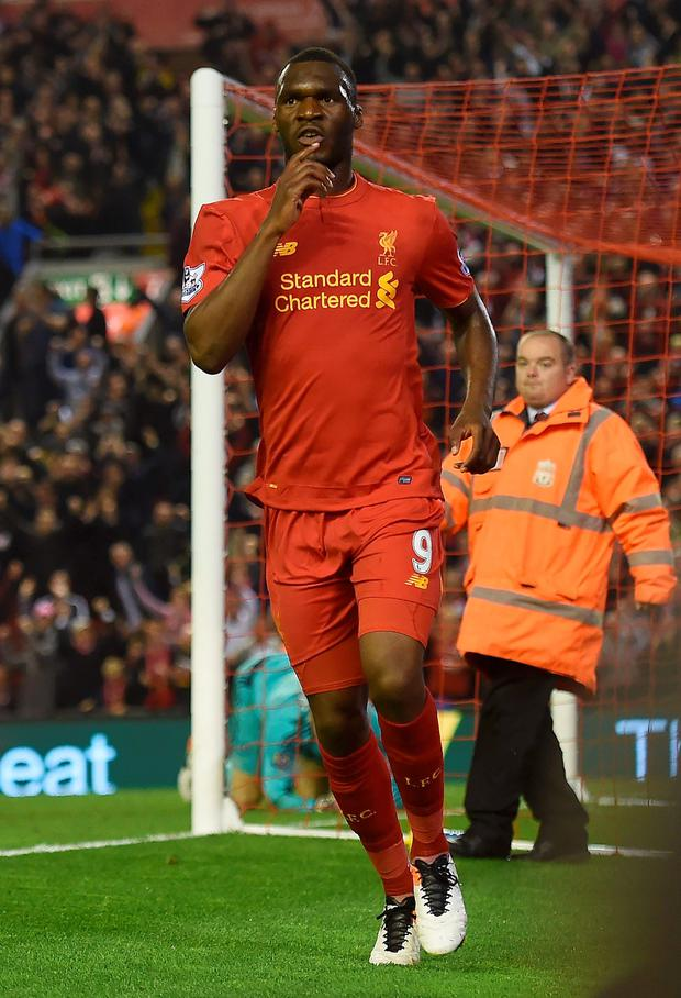 Liverpool's Christian Benteke celebrates after scoring his team's first goal during the English Premier League football match between Liverpool and Chelsea at Anfield in Liverpool, north west England on May 11, 2016. AFP/Getty Images