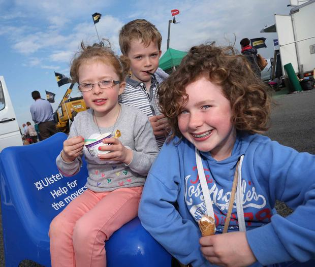 Hannah (8), Connor (8) and Sarah Graham (11) from Newry enjoy ice cream on the first day of the Balmoral Show yesterday