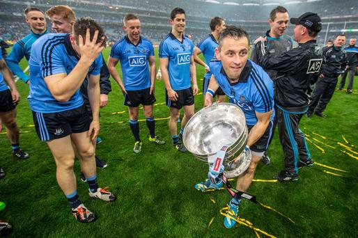 Sam you win: Dublin's Alan Brogan celebrates with the Sam Maguire Cup after last year's final but keeping hold of the trophy will be a tough ask for Jim Gavin's men