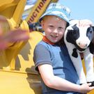 Max Watson and cow Daisy from Coleraine at the Balmoral Show at the Eikon Exhibition Centre, Balmoral Park near Lisburn, Co Antrim. Picture By: Arthur Allison Pacemaker Press