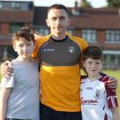 Star player: Brian Neeson with two young fans