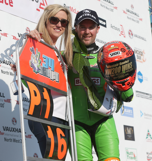 Man to catch: Alastair Seeley celebrates his Supersport race success at the North West 200 with girlfriend Dani Henry