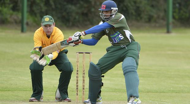Ton up: Downpatrick's Amit Patil pulls out a big shot on his way to a total of 102 not out